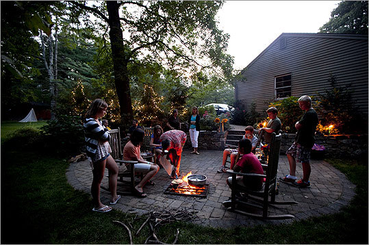 At Bob and Deb Sojka's home in Littleton, friends gather around the in-ground fire pit on their backyard patio. The Sojkas grill vegetables and cook all kinds of food -- from pancakes to pizza.