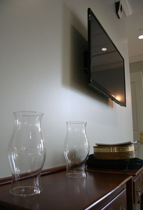 Flat screen TVs are placed throughout the facility, a stark contrast next to the existing symbols of worship.