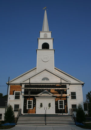 After 13 years of opposition, discussion, and compromise, Hingham's South Shore Baptist Church has reopened in a space more than twice its original size, to serve a congregation that has grown to about 700 members. The $200,000 left over from the construction of the addition was used to renovate the existing church. The siding was taken off to match the new building and insulation was put in the walls, something that wasn't considered when the church was built in the 1950s. Click here to read the complete story.