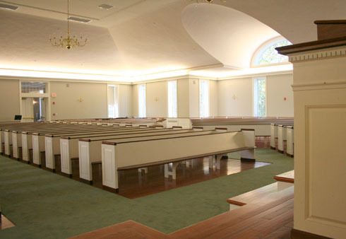 The space brings in lots of light, and is filled mostly with pews from the old Meeting Hall. Matching pews were created to double the seating in the new portion of the building.