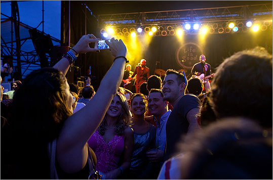 Fans posed for a photo during the Raphael Saadiq performance.