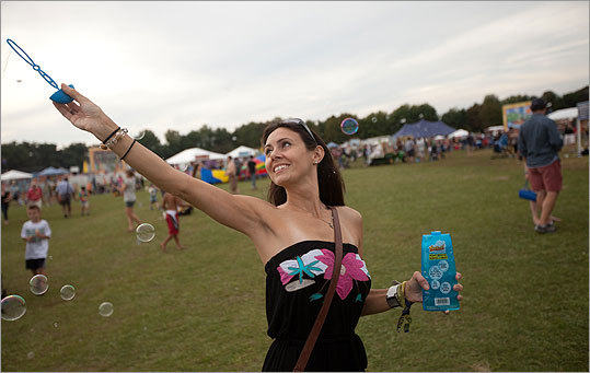 Nicole LaPlume of Chestnut Hill spread a little joy though the crowd. 'Everybody loves bubbles,' LaPlume said.