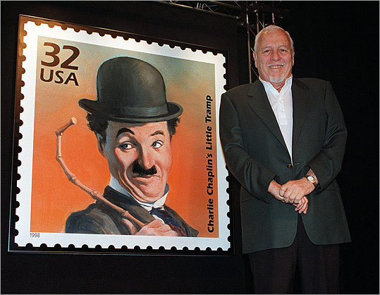 Silent film star Charlie Chaplin also had two acting sons to share the screen. Chaplin cast Sydney in his final film, 1967's 'A Countess From Hong Kong,' and both Sydney and Charles Chaplin Jr. in his last US film, 1952's 'Limelight.' Pictured: Sydney Chaplin with a stamp featuring his father in 1998.