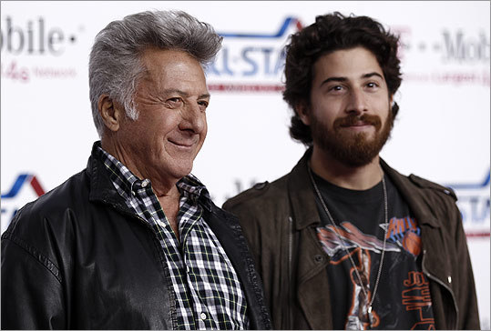 How's this for a familial twist? In 2010's 'Barney's Version,' Dustin Hoffman plays the grandfather while his actual son, Jake, fills the role of grandson. Stuck in the middle is the unrelated Paul Giamatti. However, Giamatti's character's connection to his on-screen father is so important to the film that it's as if they share the same DNA. Pictured: Father and son at the 2011 NBA All-Star Game in Los Angeles.