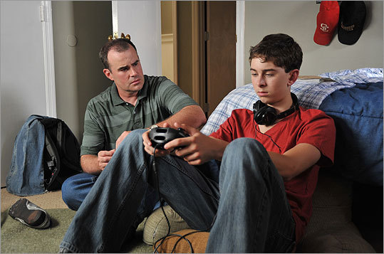 Writer-director and lead Alex Kendrick (left) and Rusty Martin play father and teenage son in 'Courageous.'