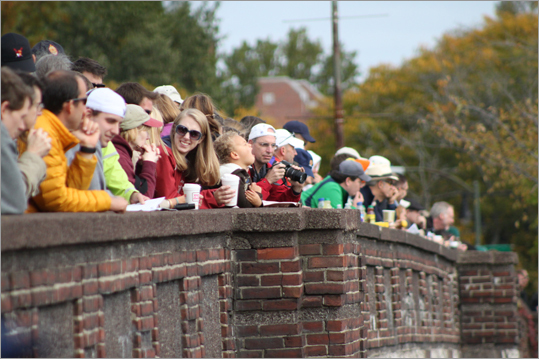 Spectators sipped their morning coffees along the sidewalks of the Larz Anderson bridge on Saturday morning.