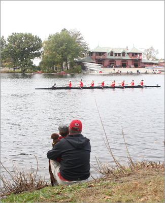 Greg Kirwan and his grandson Greg Kirwan III came from North Kingston, RI to see the regatta. Here, the pair watched crews pass from a tranquil spot between the Larz Anderson bridge and the Eliot Bridge along Memorial Drive.
