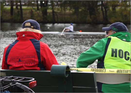 Lisa Boes (left) and Phil Fisher, umpires for the Head of the Charles, kept a close eye on the racers from their post along the north bank of the Charles.