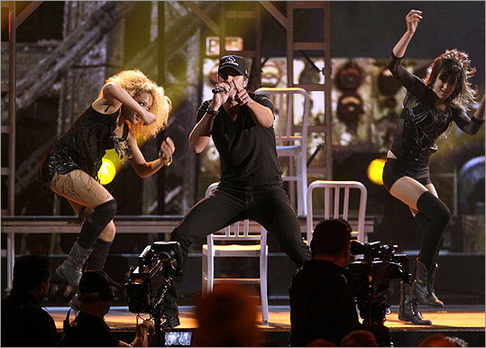 New artist of the year nominee Luke Bryan gave a spirited rendition of 'Country Girl (Shake It For Me)' with his back-up dancers.