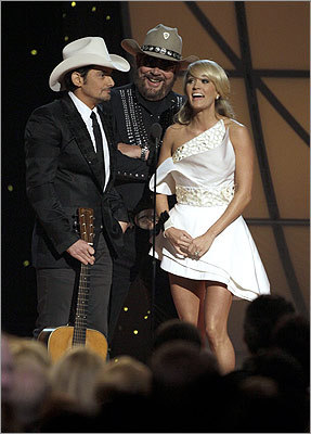 Hosts Brad Paisley (left) and Carrie Underwood poked some fun at Hank Williams Jr., who joined them during the show's opening sketch.