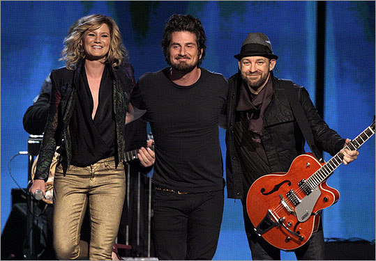 Jennifer Nettles (left) and Kristian Bush (right) of Sugarland take a bow with Matt Nathanson after their performance of 'Run.'
