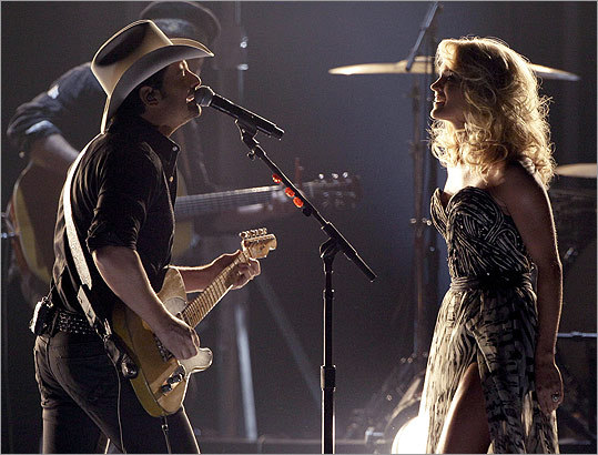 Show hosts Carrie Underwood (right) and Brad Paisley played 'Remind Me.'