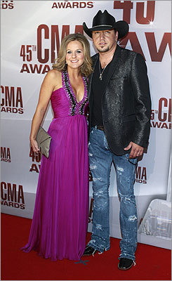 Singer Jason Aldean and his wife, Jessica, arrived. Aldean is nominated for album of the year and musical event of the year.
