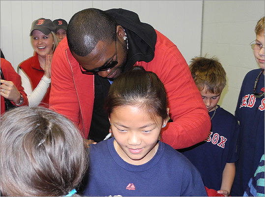 Big Papi also signed the shirts on kids' backs. Here he is signing the back of Lia, 11, of Newton and Brookline. Lia raised money for the Animal Rescue League of Boston by making key chains. She's a big Red Sox fan who watches the games with her mom.