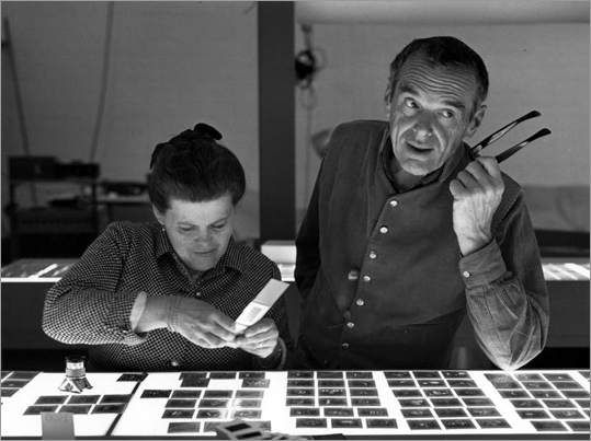 Ray and Charles Eames selecting slides for the exhibition, Photography & the City, 1968, as seen in 'Eames: The Architect and the Painter,' a documentary film directed by Jason Cohn and Bill Jersey.