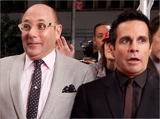 A New Year's kiss doesn't mean anything is going to 'happen.' Take for instance a scene in 'Sex and the City: The Movie' set to 'Auld Lang Syne.' Two gay friends, Stanford (Willie Garson, left) and Anthony (Mario Cantone), both anxiously look around at couples kissing at midnight, throw back a drink, and swap spit. You don't want to be left out, right?