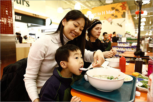 Looking to boost in-store traffic, supermarkets are winning fans with affordable, high-quality restaurants . Check out some of the options. Pictured: In Burlington, Kathleen O'Donnell of Winchester and son John eat soup from Woojeon Korean Cuisine at H Mart, where food is prepared on site.