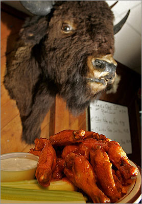 "Buff's Pub GRADE : 7.81 Under the watchful gaze of Buff the buffalo (pictured), these wings arrived rumored to be the Boston area's closest cousin to authentic Buffalo wings. That notoriety still didn't cause these Buffalonians to put Buff's atop their list, even with rave reviews. ""Very close to home,'' said Perla. ""Great size, crisp, nice sauce, perfect amount.'' Blum echoed Perla. 'Pretty well lived up to the hype!' 317 Washington St., Newton, 617-332-9134, www.buffspubofnewton.com"