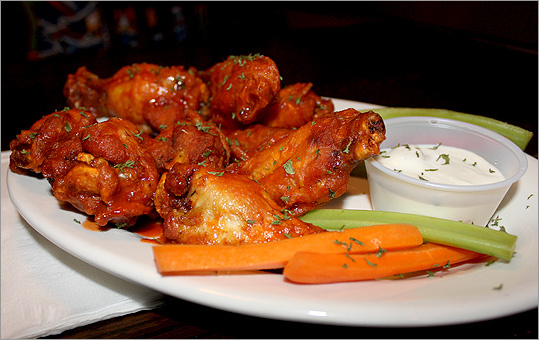"The Jeanie Johnston Pub GRADE : 4.3 While several said this could be their hang out, the waitress asked if they'd like blue cheese, which immediately brought groans. The authentic Buffalo experience mandates blue cheese, carrots, and celery with wings. ""Come on, lady, get it together,'' Perla said. As for the wings, ""I was feeling pretty good about them until [Miano] pointed out that the meat was poor-quality - moth-balled cabinet smell,'' said Blum. 'I just can't get over that stench,' said Miano. 'My beer tasted like that, too.' 144 South St., Jamaica Plain, 617-983-9432, www.jeaniejohnstonpub.com"