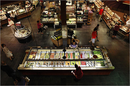 """Wegmans The word """"supermarket"""" doesn't do justice to the new, 138,000-square-foot Wegmans in Northborough, New England's largest grocery store. You'll find local products like beef from the Berkshires, some 400 cheeses, and wines from $6 to $700 in the 3,500-bottle liquor store. The prepared-foods area alone qualifies this place as a – what, super-mega-market? 9102 Shops Way, Northborough, 508-936-1900, wegmans.com"""