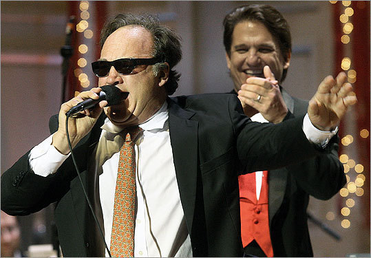 Dec. 14 in Boston Pictured: Belushi (front) with Pops conductor Keith Lockhart at the 28th annual 'A Company Christmas at Pops.'