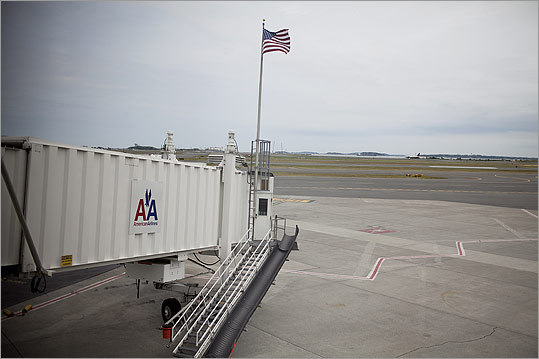 By Yoon S. Byun Logan Airport, Boston, July 25 This was for a story on the 10th anniversary of September 11th. We had special access to photograph at the airport. That flag was put up at the gate at Terminal B where Flight 11 flew from, to commemorate the people who perished. An American Airlines pilot told us about it; we walked over and photographed it. It&#146;s not a very compelling thing to look at, so I was trying to find the best way to evoke some mood. It&#146;s static and straightforward; it had a somber feel. You don&#146;t see any airplanes on the runway, to invoke that feeling of loss.