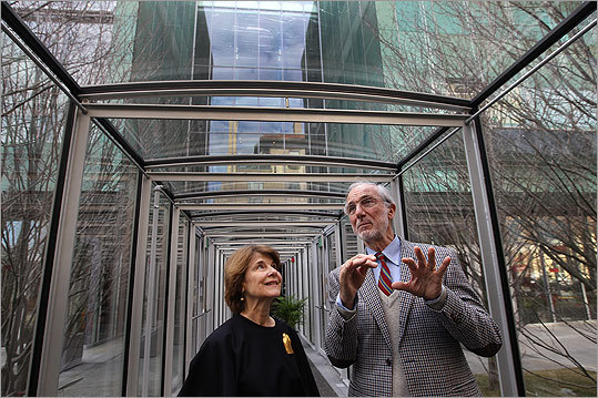 Anne Hawley stood with architect Renzo Piano in the glass corridor of the finished new wing at the Gardner Museum on Jan. 11, 2011.