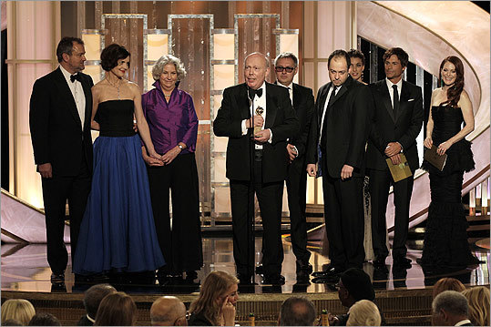 Julian Fellowes (center) accepted the award for best mini-series or motion picture made for TV for 'Downton Abbey.'