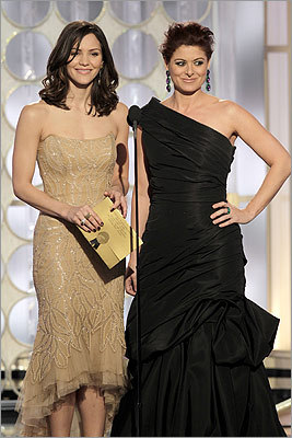 One-time Boston Conservatory student Katharine McPhee (left) and former 'Will & Grace' actress Debra Messing, who co-star in the new series 'Smash,' presented the award to Elba.