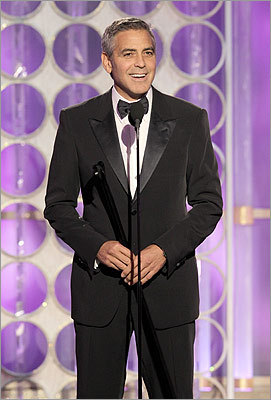 Perhaps still with a tan from shooting in Hawaii, George Clooney won best actor in a drama for 'The Descendants.'