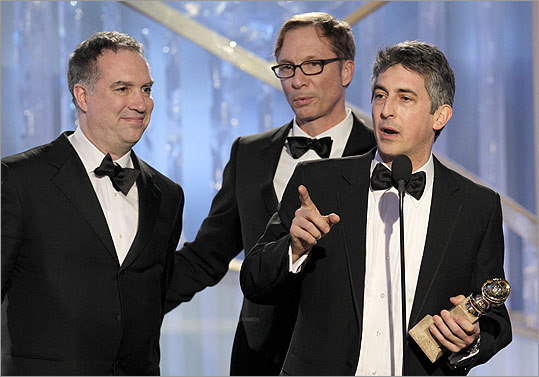 Director Alexander Payne (at microphone), Jim Taylor (left), and Jim Burke accepted the award for best motion picture drama for 'The Descendants.'