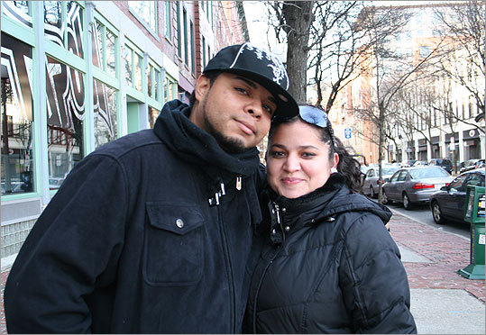 We asked New York resident Barry Negron (left), with Daisy Pascual, also from New York, what he thought about the upcoming match-up in Indianapolis. 'I hate the Giants and I hate the Patriots but I despise the Giants so much that I'm rooting for the Patriots,' Negron said. 'I think the Patriots are cheaters.'