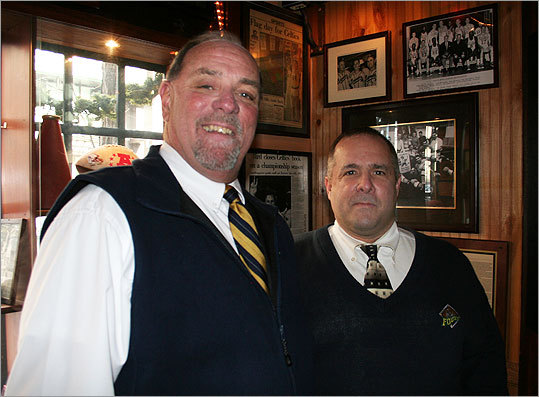 Stephen Lynch (left) and Mark DeGeorge work the door at the Canal Street sports bar The Fours. DeGeorge, who took Super Bowl Sunday off to watch the game at a friend's house, predicted that the game would be a win for New England, 'by two touchdowns.'