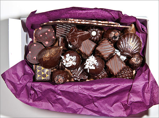 """Chocolee Chocolates Choose from the large display case ($1 to $1.50 per piece): clamshells, cones with gold edges, coconut-topped domes, and ultra-thin bark, which are packed in a brown box, the layers separated with tissue. """"Box has a stylish, but homemade quality,'' """"unusual flavors, such as dried fig with marzipan,'' """"chocolate-dipped fig looks amazing,'' """"creamy, intense chocolate, very fresh, truffle inside wonderful,'' """"caramel intense but not too chewy,'' """"caramel gooey but not too sweet,'' """"the way dark chocolate should be.'' Others: """"licorice an unpleasant surprise,'' """"spicy filling is strange.'' 23 Dartmouth St., South End, Boston, 617-236-0606, www.chocoleechcolates.com"""