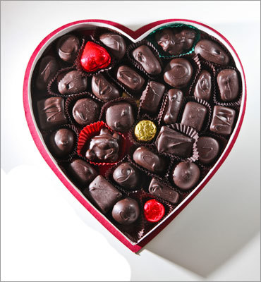 """Nichols Candies The store, owned by Barbara Nichols, is a throwback to the 1950s. About 34 pieces come in a white and red heart box ($20.95 a pound), which looks a little like a Russell Stover assortment. Hearts are wrapped in red foil. Tasters said, """"good nut clusters,'' """"wonderful peanut brittle square,'' """"caramel without the trendy salt,'' """"love the fact that someone put an """"R'' on raspberry, """"C'' on coconut,'' """"exactly like a peppermint patty, refreshing.'' Then: """"caramel chewy but too tough,'' """"grocery store chocolate,'' """"tasteless compared to the others,'' """"not very bold,'' """"fillings taste medicinal.'' 1 Crafts Road, Gloucester, 978-283-9850, www.nicholscandies.com"""