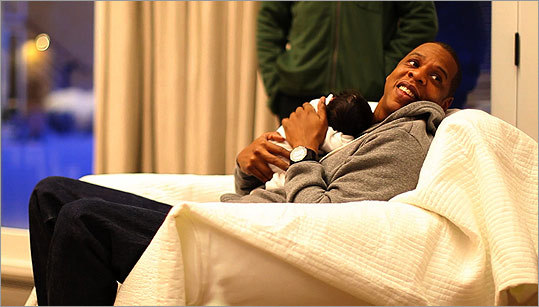 Jay-Z smiled as he hugged his daughter.