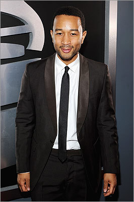 John Legend wore a classic look with slender tie.