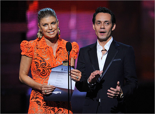 Fergie (left) and Marc Anthony announced the award for best rap performance, which went to Jay-Z and Kanye West for 'Otis.' The presenters accepted the award on behalf of the artists.