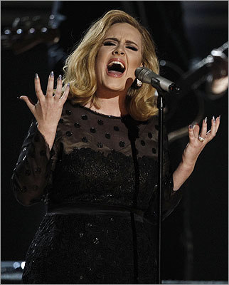 After throat surgery to repair damaged vocal cords, Adele made a triumphant return to the stage, performing 'Rolling in the Deep' to a standing ovation.