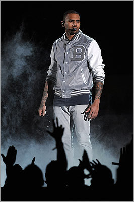 After LL Cool J said his job was to keep the show moving, Chris Brown gave a fitting high-energy performance.
