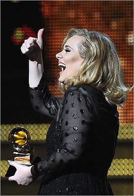 Adele gave the thumbs up as she received her fifth trophy of the night for record of the year.
