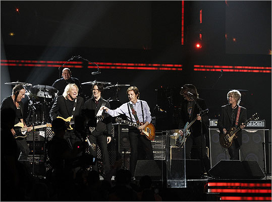 From left: Bruce Springsteen, Joe Walsh, Rusty Anderson, Paul McCartney, Dave Grohl, Brian Ray, and Abraham Laboriel Jr. (on drums) jammed on a closing medley of 'Golden Slumbers,' 'Carry That Weight,' and 'The End.'