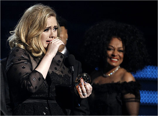 Adele got emotional after winning the award for album of the year for '21,' as Diana Ross looked on. Adele drew laughs when she admitted, 'Oh, I've got a bit of snot.'