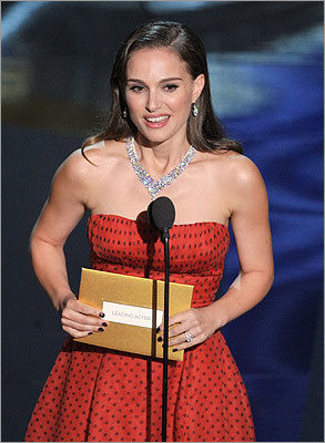 Natalie Portman, last year's best actress, presented Dujardin with the award.