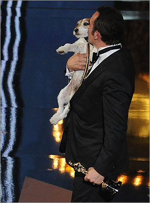'The Artist' star Jean Dujardin, who also won best actor, planted a kiss on the movie's star dog, Uggie, after winning best picture. The movie took home five awards in all, including three of the major categories.