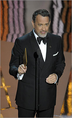 After jokingly pointing out a seat-filler, Tom Hanks presented two awards for cinematography and art direction, both of which went to 'Hugo.'