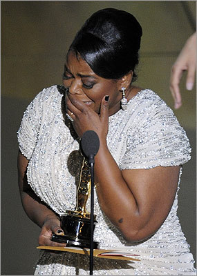 Octavia Spencer cried as she accepted the award for best actress in a supporting role for 'The Help.' It was her first Oscar and she thanked the Academy for giving her 'the hottest guy in the room.'