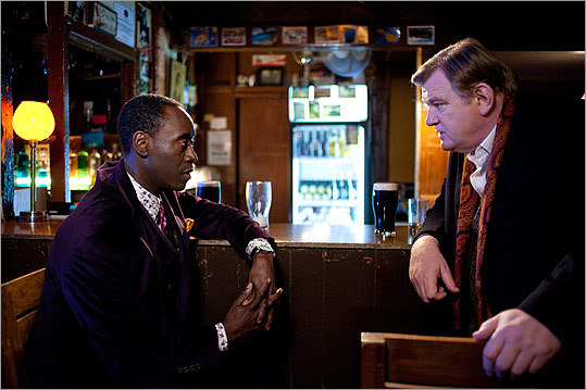 The Mismatched-Cop Comedy The Guard (2011) pits Don Cheadle (left) as an FBI agent investigating drug-smuggling with an Irish cop, played by Brendan Gleeson. Kevin Cullen says: Gleeson plays a tired, cynical cop in Connemara who lights up only for booze and hookers. Cheadle is the FBI agent who gets the best of his Irish partner. The screenplay is by John Michael McDonagh, brother of Martin McDonagh who made Gleeson only slightly less cynical in 'In Bruges.'