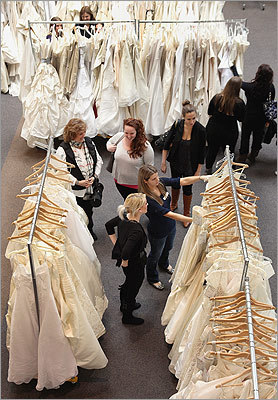 Military brides-to-be sifted through more than 170 wedding gowns as part of Project Dream Dress Give-Away at Morgan Memorial Goodwill Industries in Boston on March 3.
