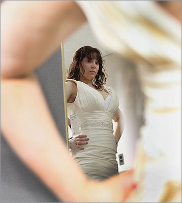 Brides-to-be, like Kimberly Rogers of Tewksbury who tried on a gown for her August nuptials, registered in advance online. Brides Across America opened the event to women in the service or who have served within the last five years, as well as those who are engaged to a member of the military or engaged to recent veterans.